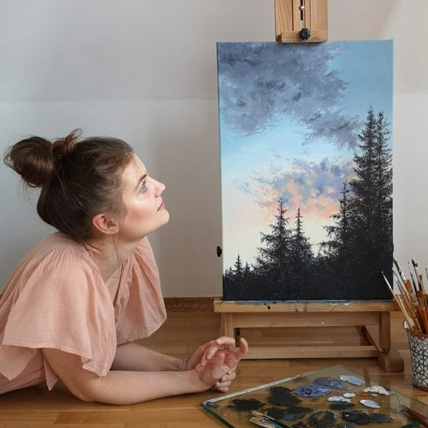 artist posing with her painting
