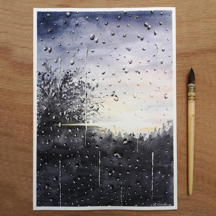 watercolor painting of rain on a window laying on a desk