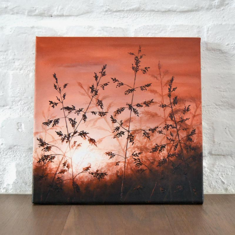 painting of a meadow grass leaning against the wall