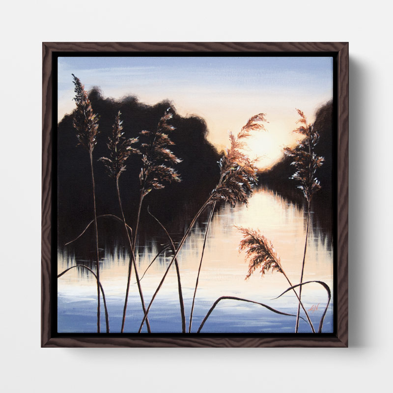 framed painting of a sunset