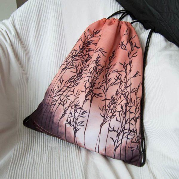 orange drawstring bag on a white armchair