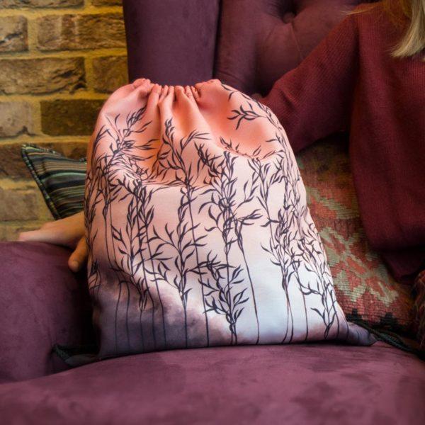 orange drawstring bag on a red armchair