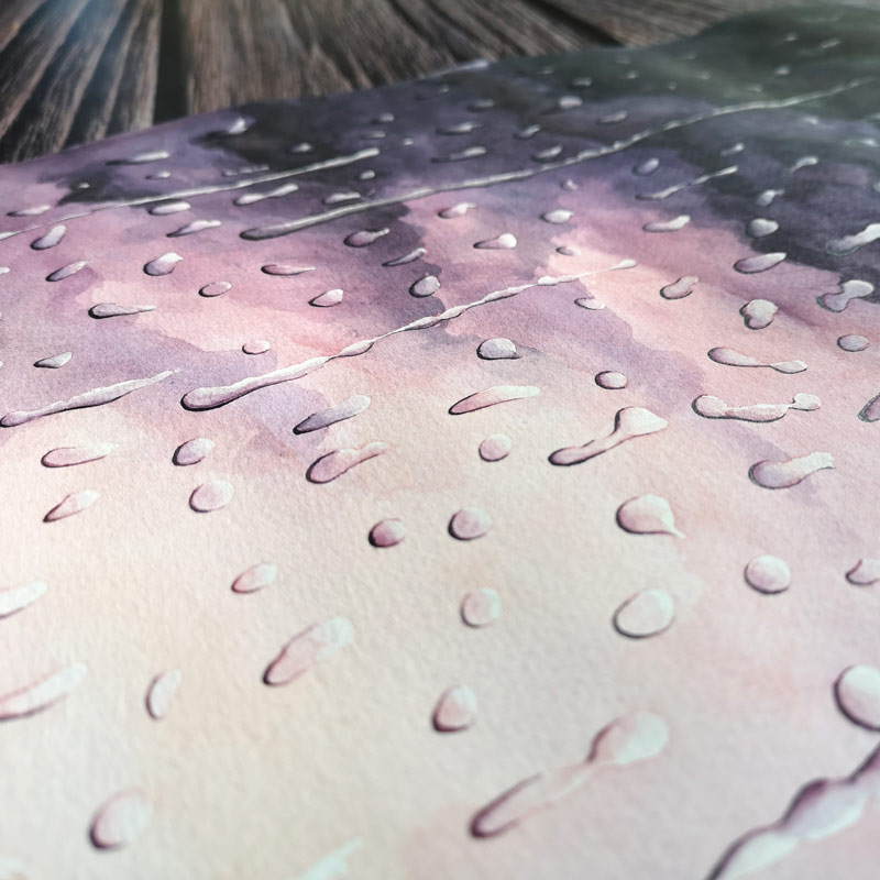 rain painting on paper laying on a desk
