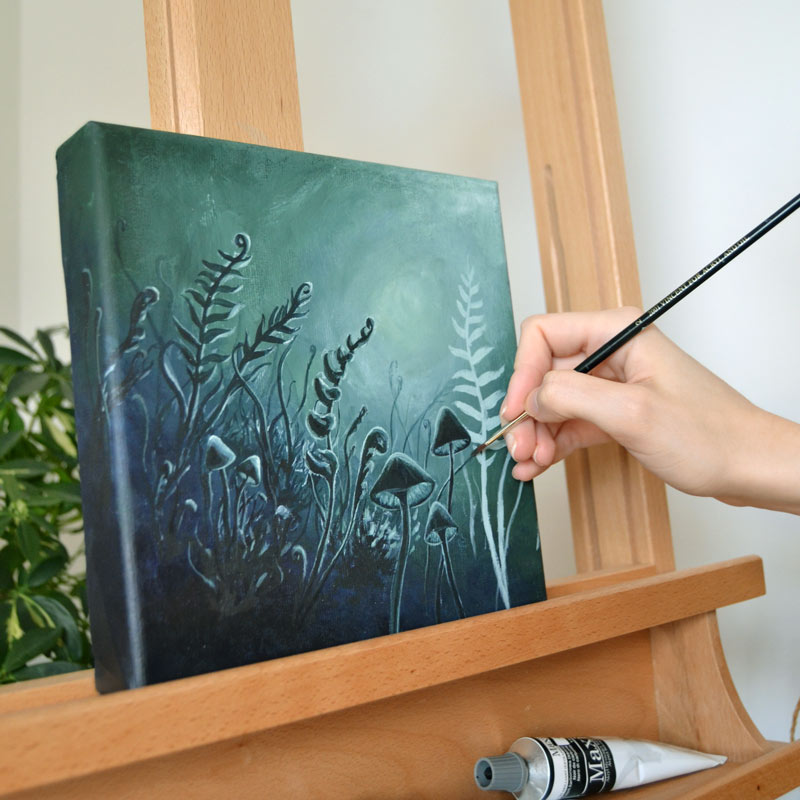 person painting on a canvas